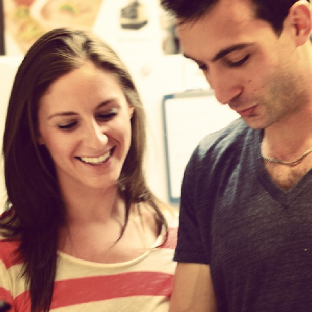smiling and looking down, Lenny Gale and Naomi Fox work in kitchen for My Girl blog post
