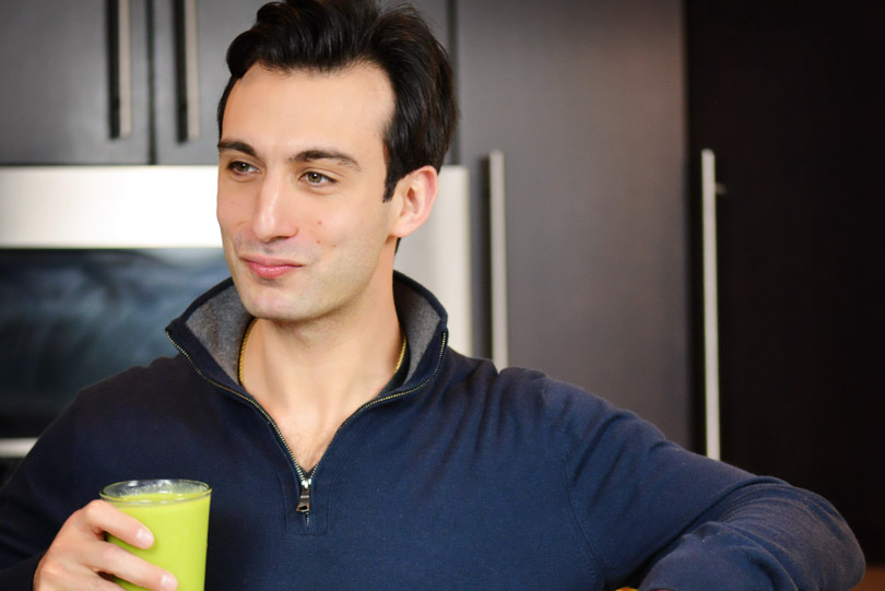 Lenny Gale smiling with a green smoothie.
